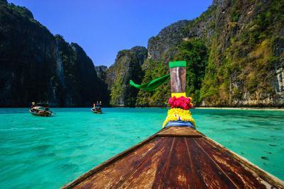 Traditional Longtail Boat in Maya Bay on Koh Phi Phi Leh Island, Krabi, Thailand