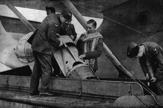 Loading bombs on to an RAF aircraft during World War II, c1940 (1943)-Unknown-Photographic Print