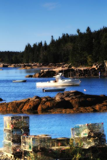 Lobster Traps Stacked on Shore, with Lobster and Row Boats Anchored Offshore-Robbie George-Photographic Print