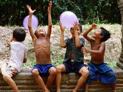Local Boys Toss Balloons Outside Preah Kahn Temple, Siem Reap, Cambodia-Daniel Boag-Photographic Print