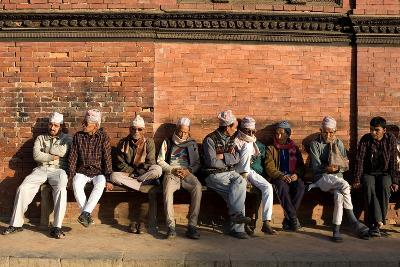 Local Men Sit on a Bench in Patan Durbar Square-Dmitri Alexander-Photographic Print