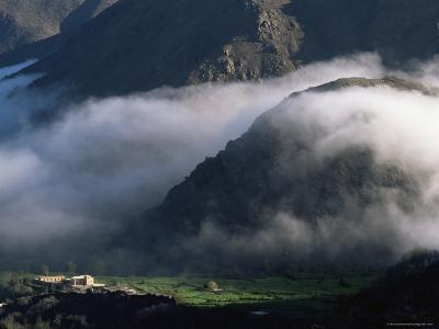 Local School Below Mist Rising in Valley of the High Atlas Mountains, Morocco, North Africa, Africa-David Poole-Photographic Print