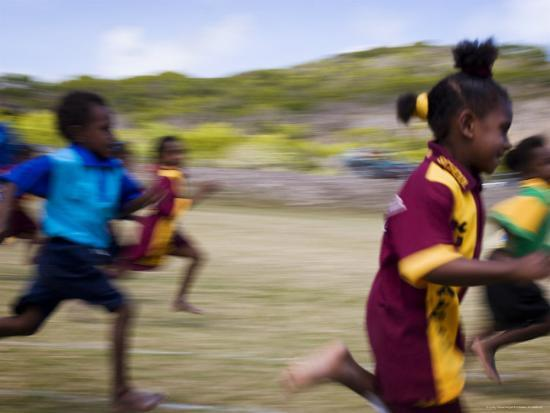 Local School Girls Competing in Race During an Inter-Island School Sports Carnival-Tim Barker-Photographic Print