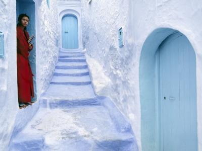 Local Woman Steps Out into Whitewashed Streets of Rif Mountains Town of Chefchaouen, Morocco-Andrew Watson-Photographic Print