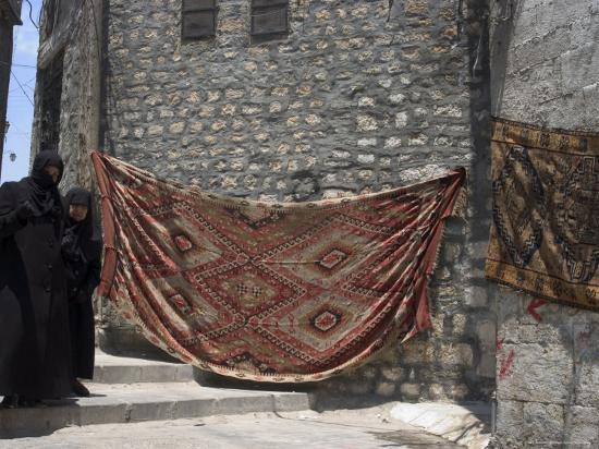 Local Woman Walking Down Steps, Blanket on Wall, Aleppo (Haleb), Syria, Middle East-Christian Kober-Photographic Print