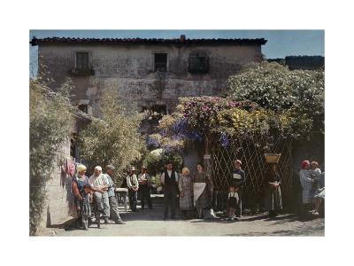 Locals Gather under Flowered Gateways Outside Rome-Hans Hildenbrand-Photographic Print