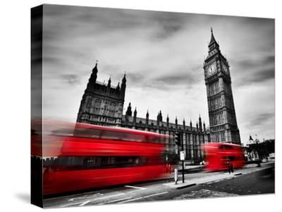 London, the Uk. Red Buses in Motion and Big Ben, the Palace of Westminster. the Icons of England In-Michal Bednarek-Stretched Canvas Print