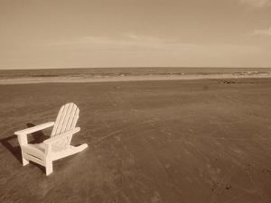 Lone Chair on Empty Beach