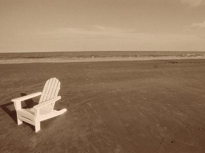 Lone Chair on Empty Beach--Photographic Print
