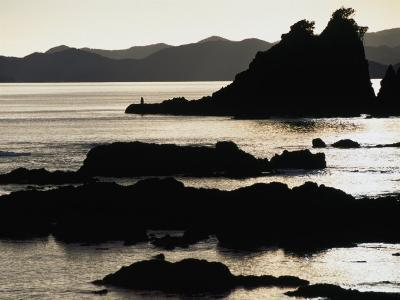 Lone Fisherman on Rocks at Sunrise in Russell, Bay of Islands, Northland, New Zealand-Stephen Saks-Photographic Print