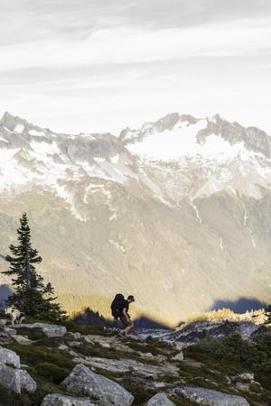 https://imgc.artprintimages.com/img/print/lone-man-backpacks-down-a-ridge-in-the-north-cascades-to-his-camp-site-in-washington_u-l-q1bbhw30.jpg?p=0
