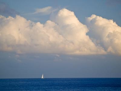 Lone Sailboat Sailing Along the Horizon in France-Michael Melford-Photographic Print