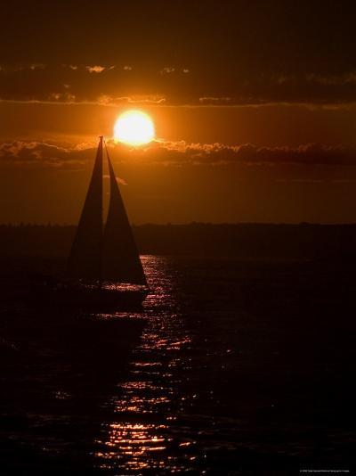 Lone Sailboat Silhouetted by the Setting Sun-Todd Gipstein-Photographic Print