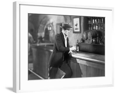 Lonely Man Standing at a Bar Counter with a Drink--Framed Photo