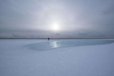 https://imgc.artprintimages.com/img/print/lonely-person-in-icelandic-lowlands-with-blue-puddle-of-water-and-sun-in-the-background-winter_u-l-q1bz9ne0.jpg?p=0