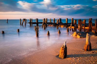 Long Exposure at Sunset of Pier Pilings in the Delaware Bay at Sunset Beach, Cape May, New Jersey.-Jon Bilous-Photographic Print