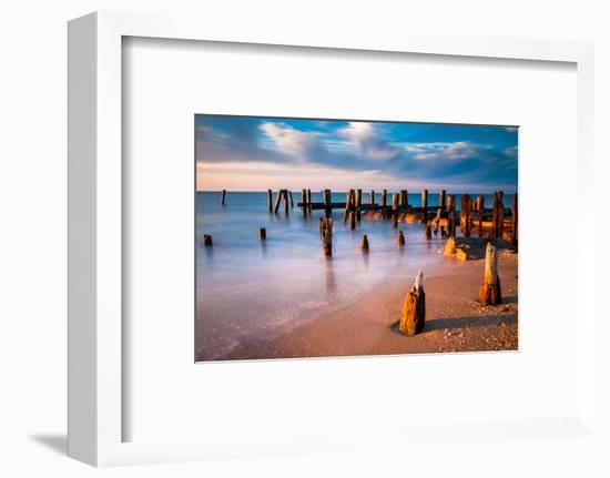 Long Exposure at Sunset of Pier Pilings in the Delaware Bay at Sunset Beach, Cape May, New Jersey.-Jon Bilous-Framed Photographic Print