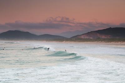 Long Exposure of Surfers Enjoy the Wave on Praia Da Joaquina Beach-Alex Saberi-Photographic Print