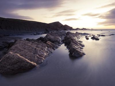 Long Exposure of Waves Moving over Rocks on Crackington Haven Beach at Sunset, Cornwall, England-Ian Egner-Photographic Print