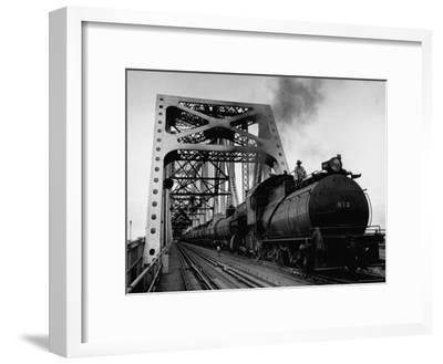 Long String of Tank Cars Rumbling Across the 4 1/2 Mile Huey Long Bridge at New Orleans-Peter Stackpole-Framed Premium Photographic Print