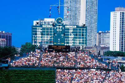 Long view of scoreboard and full bleachers during a professional baseball game, Wrigley Field, I...--Photographic Print