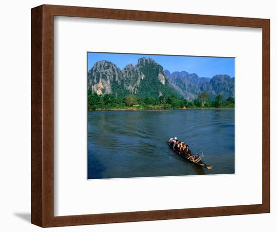 Longboat Crossing Nam Song from Limestone Formations with Honeycomb Caves, Vang Vieng, Laos-Kraig Lieb-Framed Photographic Print