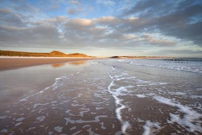 Looking across Embleton Bay Just after Sunrise Towards the Sunlit Sand Dunes-Lee Frost-Photographic Print