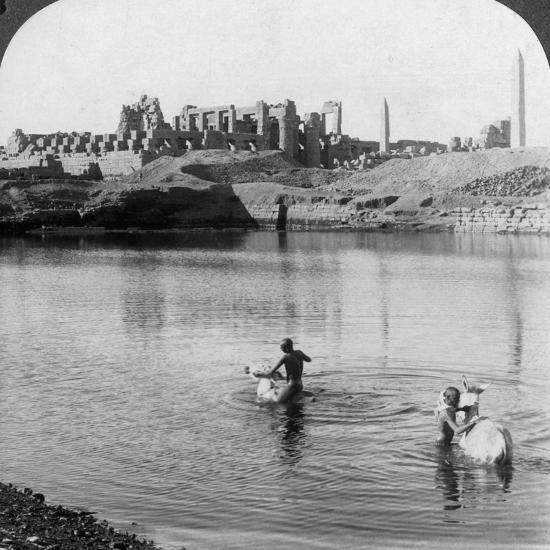 Looking across the Sacred Lake to the Great Temple at Karnak, Thebes, Egypt, 1905-Underwood & Underwood-Photographic Print