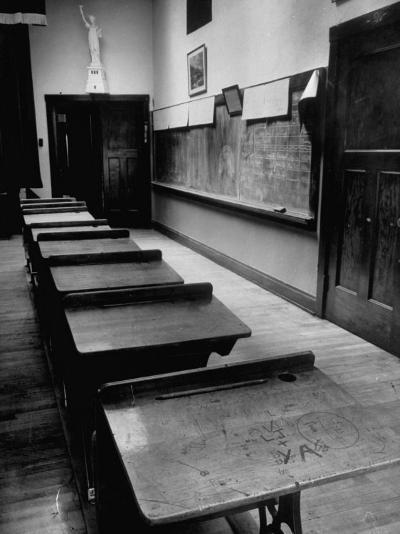 Looking Down Row of Empty Scarred Old Fashioned Desks in Schoolroom-Walter Sanders-Photographic Print