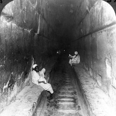 Looking Down the Main Passage to Khufu's Sepulchre Within the Great Pyramid, Egypt, 1905-Underwood & Underwood-Photographic Print