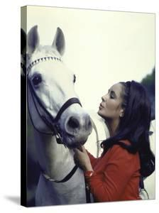 "Actress Elizabeth Taylor with Horse During Filming of ""Reflections in a Golden Eye"" by Loomis Dean"