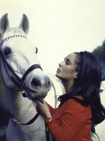 """Actress Elizabeth Taylor with Horse During Filming of """"Reflections in a Golden Eye"""""""