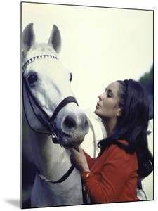 """Actress Elizabeth Taylor with Horse During Filming of """"Reflections in a Golden Eye"""" by Loomis Dean"""