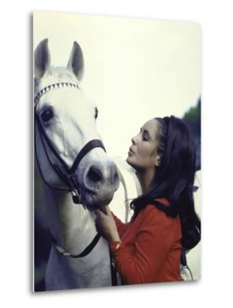 "Actress Elizabeth Taylor with Horse During Filming of ""Reflections in a Golden Eye"""