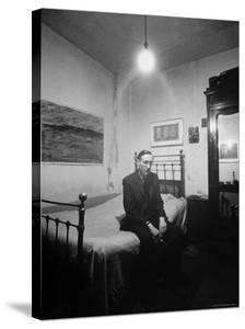 "Author William Burroughs, an Ex Dope Addict, Relaxing on a Shabby Bed in a ""Beat Hotel"" by Loomis Dean"