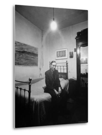 "Author William Burroughs, an Ex Dope Addict, Relaxing on a Shabby Bed in a ""Beat Hotel"""