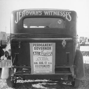 Back of Car Advertising for Jehovah's Witnesses' Activities at Wrigley Field by Loomis Dean