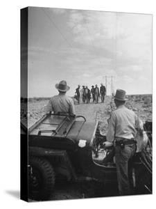 Border Patrol Waiting for Illegal Immigrants to Reach their Position by Loomis Dean