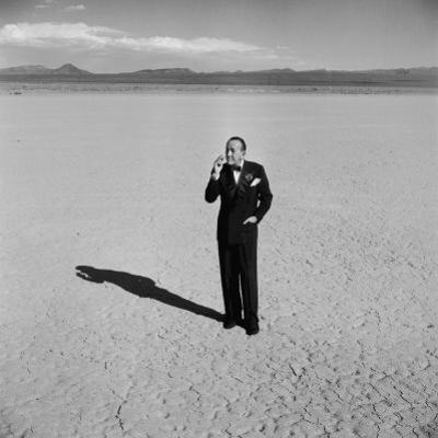 British Entertainer Noel Coward in Middle of Desert, Dressed for His Nightclub Act