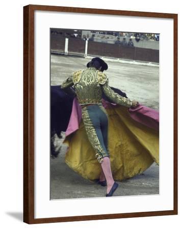 "Bullfighter Manuel Benitez, Known as ""El Cordobes,"" Sweeping His Cape Aside a Charging Bull"