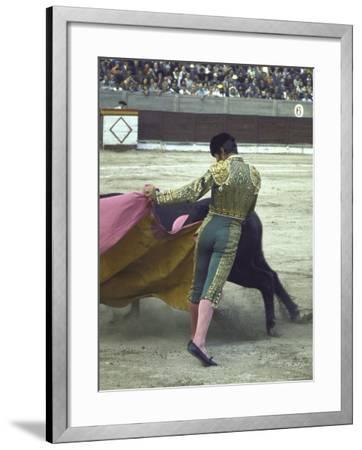 "Bullfighter Manuel Benitez, Known as ""El Cordobes,"" Sweeping His Cape Aside the Charging Bull"