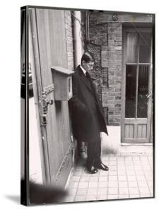Christian Dior's Successor Yves Saint Laurent Standing Alone After Attending Dior's Funeral by Loomis Dean