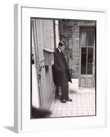 Christian Dior's Successor Yves Saint Laurent Standing Alone After Attending Dior's Funeral