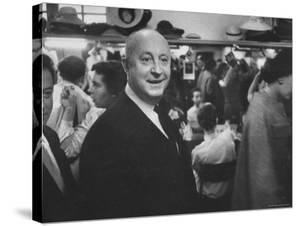 Designer Christian Dior Standing in Dressing Room at Paris Salon Before Showing of His Collection by Loomis Dean