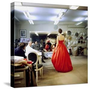 Fashion Designer Christian Dior Commenting on Red Gown for His New Collection Prior to Showing by Loomis Dean