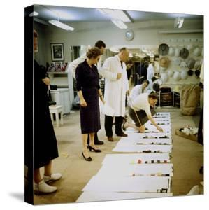 Fashion Designer Christian Dior Working on New Collection with Staff Prior to Showing by Loomis Dean