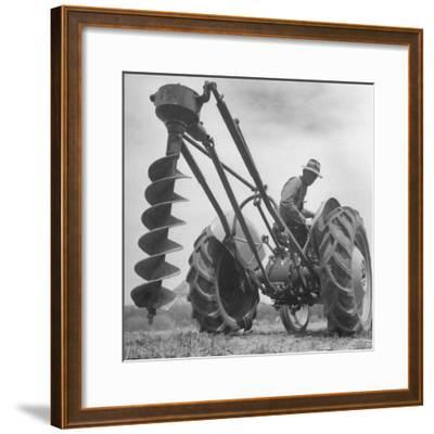 Ford Tractor with Posthole Digger Attachment