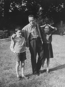 French Author Albert Camus Poised Standing on Lawn, Arms around His Twins Jean and Catherine by Loomis Dean