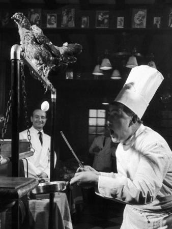 French Restaurant Owner Sam Letrone Entertaining Patrons with His Performing Chicken