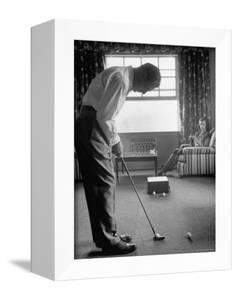 Golfer Ben Hogan Practicing Putting in His town house with Wife Valerie Watching from Armchair by Loomis Dean